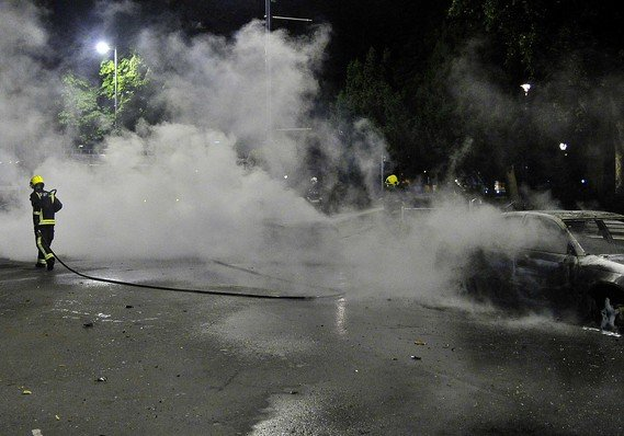 Car fire extingushed on a street in Ealing