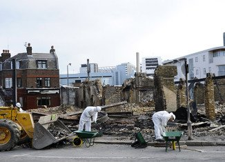 Charred remains of Reeves furniture shop Croydon, South London, following riots on Monday