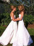 Chely Wright and Lauren Blitzer in their wedding gowns.