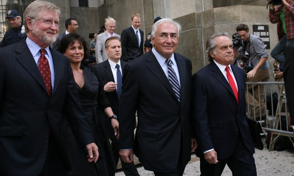 DSK walked free from New York court yesterday after charges against him for alleged sexual assault on a hotel maid have been dropped photo