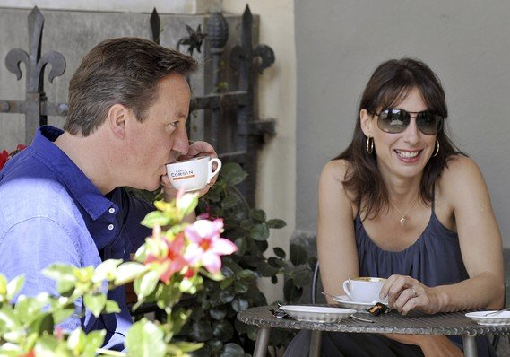 PM David Cameron and his wife, Samantha, outside a cafe near Siena Italy where they have been in vacation during the last weekend London riots