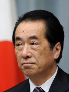 PM Naoto Kan announced on Friday that he resigned from his position as leader of the ruling Democratic Party of Japan  photo