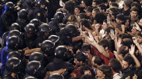 People violently protesting against the exorbitant cost of Pope Benedict XVI visit to Madrid