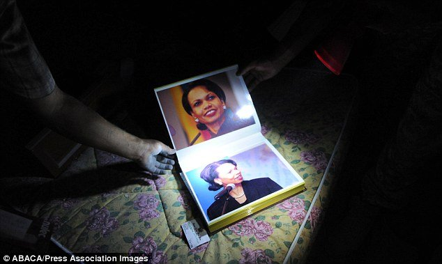 Photo album featuring Condoleezza Rice, found in Colonel Gaddafi's residence, Bab Al Aziziya