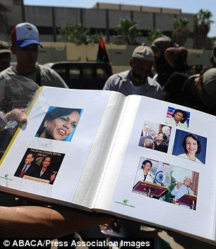 Rebels show Condoleezza Rice album found at Gaddafi's compound.