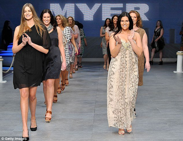 Robyn Lawley first in left the first ever plus size model to feature in Vogue Australia opened the Myer's show at Sydney Fashion Festival in a stunning black assymetric dress photo