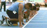 Sogelau Tuvalu was twice the size of the other six competitors and was the only athlete not wearing spikes on his shoes