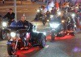 Vladimir Putin was riding a three wheeled Harley Davidson while he led the motorcade
