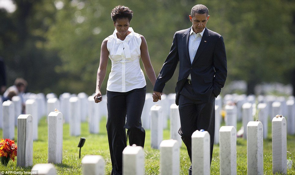 Barack Obama was seen strolling with his wife, Michelle, among graves filled with dead from the Afghanistan and Iraq wars