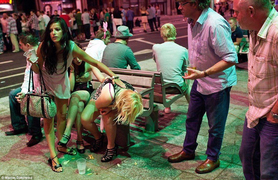 Cardiff After Dark portfolio presents the images of the British night life with young women and men vomiting and sleeping on the streets after weekend parties