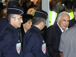 DSK and his wife, Anne Sinclair, arrived at Charles de Gaulle airport. (Reuters)