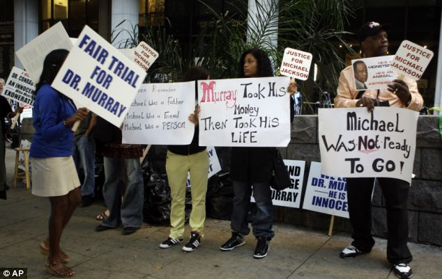 Demonstrators for and against Dr Conrad Murray