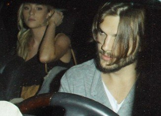 In the unearthed photographs, Ashton Kutcher is seen driving off with Sara Leal seated in the back seat of his car