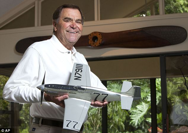 Jimmy Leeward holding a scale model of his P-51 Mustang at his Florida home in 2010
