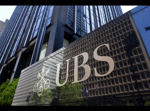 London police have arrested a man in connection with allegations of unauthorized trading which has cost Swiss banking group UBS an estimated 2 billion photo