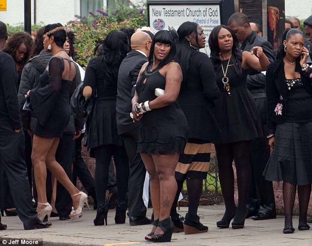 Many of the mourners stayed outside New Testament Church at Mark Duggan's funeral service