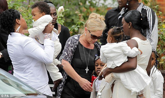 Mark Duggan's partner, Semone Wilson and his children