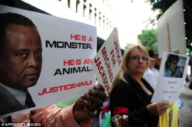 Michael Jackson supporters holding signs outside Los Angeles Superior Court