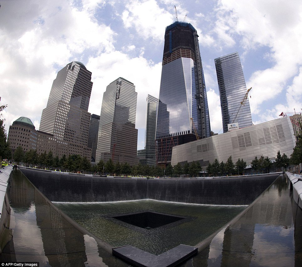National 9/11 Memorial: view from the south pool waterfall with Freedom Tower in the background