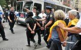 Occupy Wall Street demonstrators were arrested, cuffed with plastic tags and dragged on to sidewalks