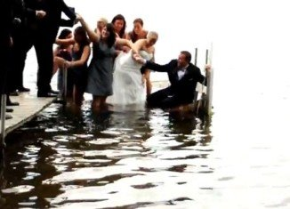 The dock over Sugarloaf Lake in Michigan collapses when the bridal group step onto it