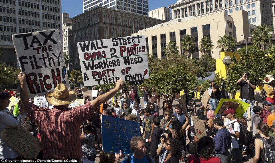 """Occupy LA"" protesters marched from Pershing Square to City Hall on Saturday, and said they would remain camped at the site ""indefinitely"", like their New York counterparts"