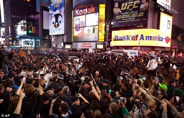 20,000 demonstrators swamped Times Square, stopping traffic, in what was thought to be the largest Occupy demonstration in the US so far