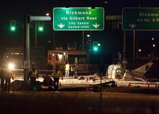 A small passenger aircraft crashed on Russ Baker Way, a busy street from Richmond, Canada, injuring all nine aboard, but miraculously all passengers were alive