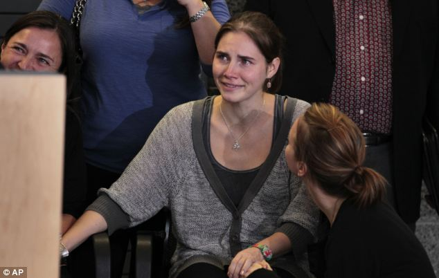 Amanda Knox and her family during a brief news conference shortly after her arrival at Seattle-Tacoma International Airport