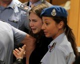 Amanda Knox bursts into tears after she was sensationally cleared of the murder of Meredith Kercher