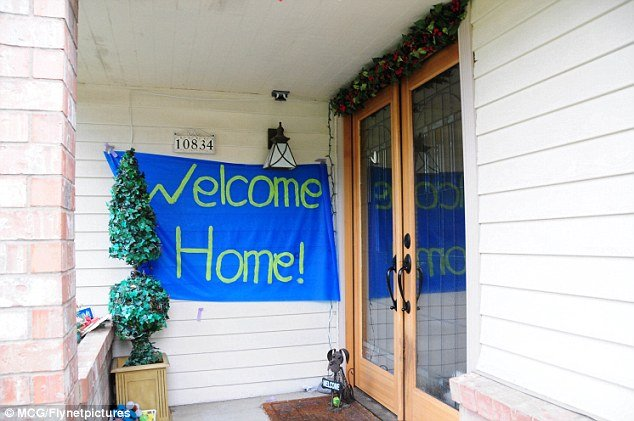 "Amanda Knox's family home in Seattle, where a giant ""Welcome Home"" banner hangs by the front door"