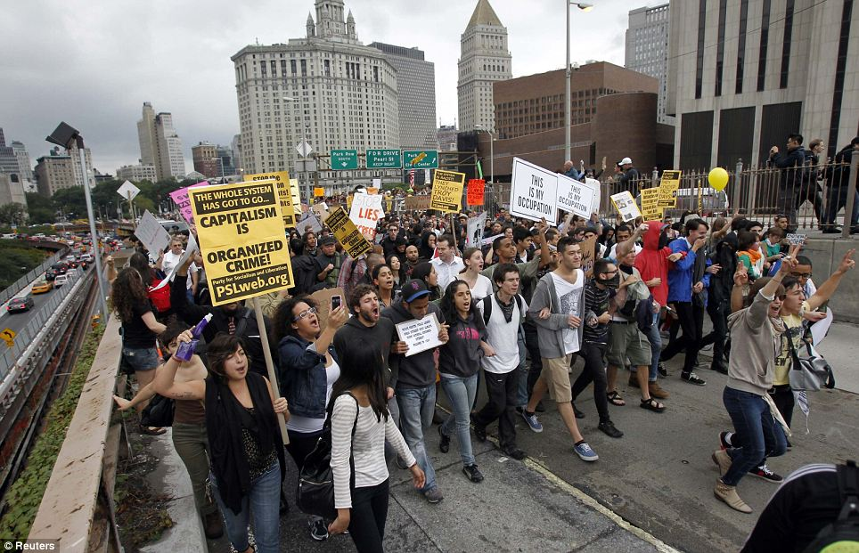 Around 1,500 protesters march over the Brooklyn Bridge in New York during an Occupy Wall Street protest