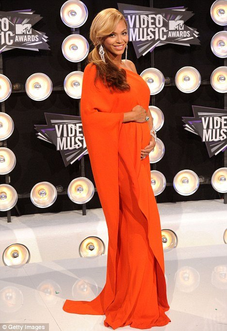 Beyoncé revealed her baby bump on the red carpet at the MTV Video Music Awards 2011