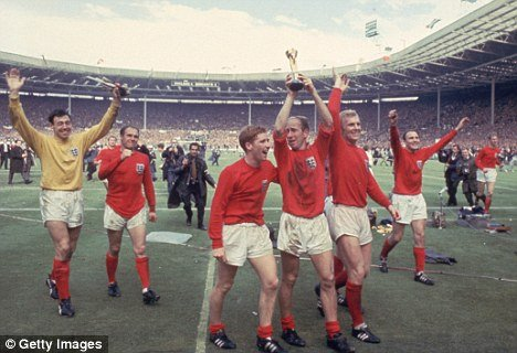 Bobby Charlton raises the World Cup trophy after England beat West Germany 4-2 at Wembley Stadium in 1966