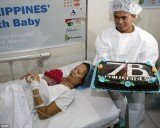 "Danica May Camacho, born in Philippines last night, has been recognized by United Nations as one of the world's symbolic ""seven billionth"" babies, presenting her with a special cake"