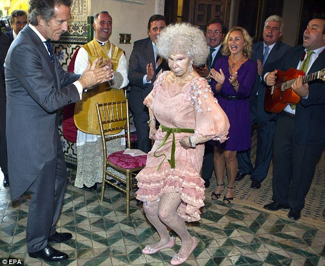 Duchess of Alba dancing with her new husband,  Alfonso Diez