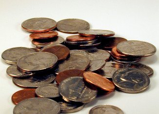 For a frugal living, start carrying a coin purse and stop treating loose change like it's the plague