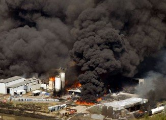 Giant plumes of noxious smoke, which could be seen for miles, rise from the Magnablend Chemical Plant, not far from houses and apartments on Highway 287 Bypass in Texas