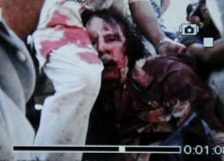 Muammar Gaddafi Wounded or Dead Corpse