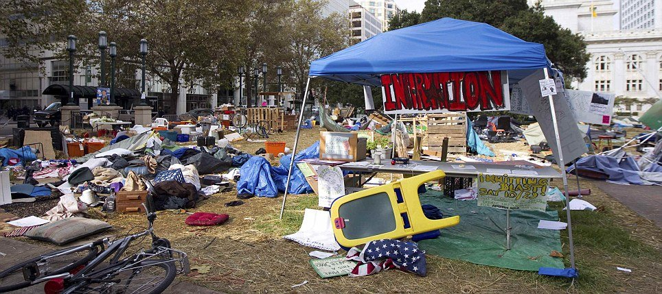 Oakland city staff warned Occupy protesters that they might have to shut down the site because camping and cooking is exacerbating an existing rat problem photo