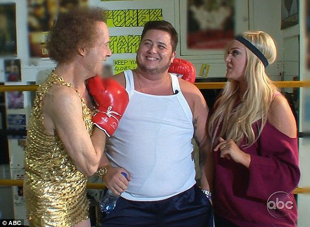 Richard Simmons coached Chaz Bono and Lacey Schwimmer dressed in a gold glitter