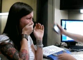 Sarah Churman cries with laughter as she hears the world around her for the first time