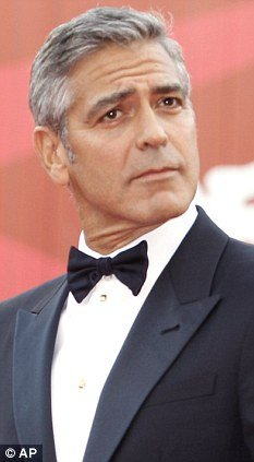 Scientists say they dont believe their anti grey pill will work on people like George Clooney whose hair has already begun the greying process  photo