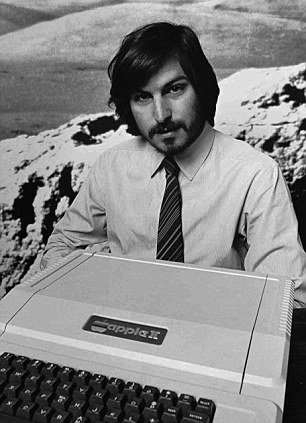 Steve Jobs holds the Apple II computer in 1977