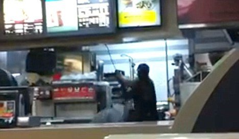 The video clip shows Rayon McIntosh a Greenwich Village McDonald's cashier viciously beating two women with a metal rod photo