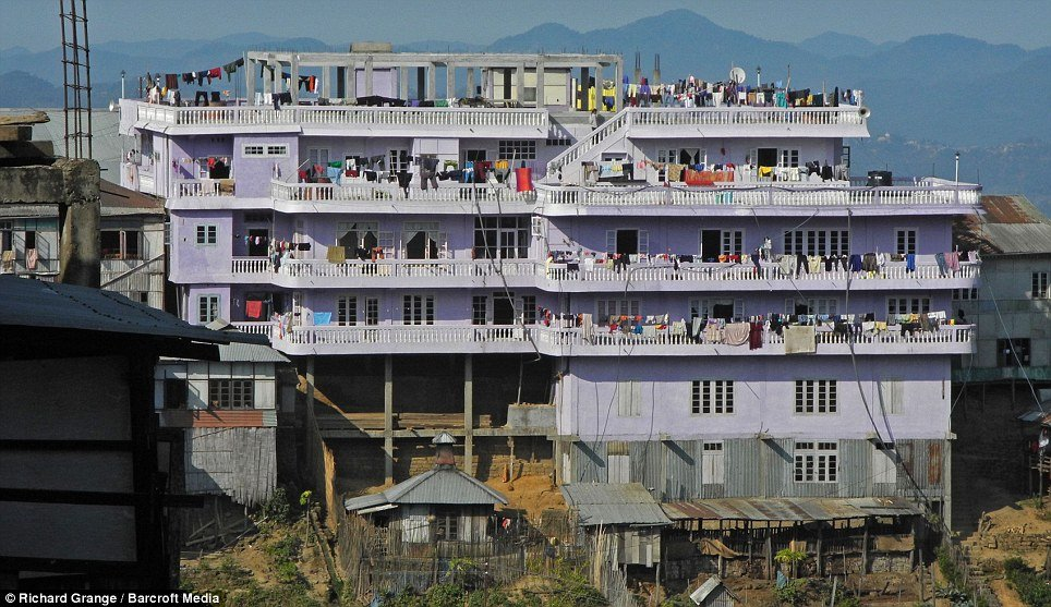 Ziona Chana's home has 100 rooms and is a four-storey house set in the village of Baktwang, state Mizoram, India