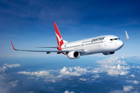 A Qantas pilot faces the prospect of losing his job after getting frisky with a first-class section female passenger on a long-haul flight between London and Sydney