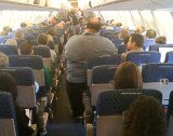 Arthur Berkowitz, an US Airways passenger had to stand during a seven-hour flight from Anchorage to Philadelphia because of a 400 lbs man sitting next to him