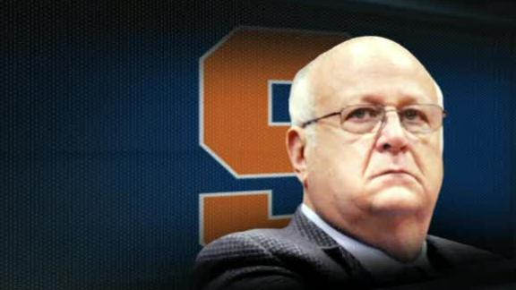 Bernie Fine, the Syracuse University basketball coach accused of sex abuse has been fired after damning new evidence suggested his wife watched him molest a boy who was staying at their house