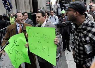"Derek and John Tabacco, two brothers who work in the financial district, stood next to the Occupy protesters holding up signs reading ""Get a job"" and ""Occupy a Desk"", before others joined them"